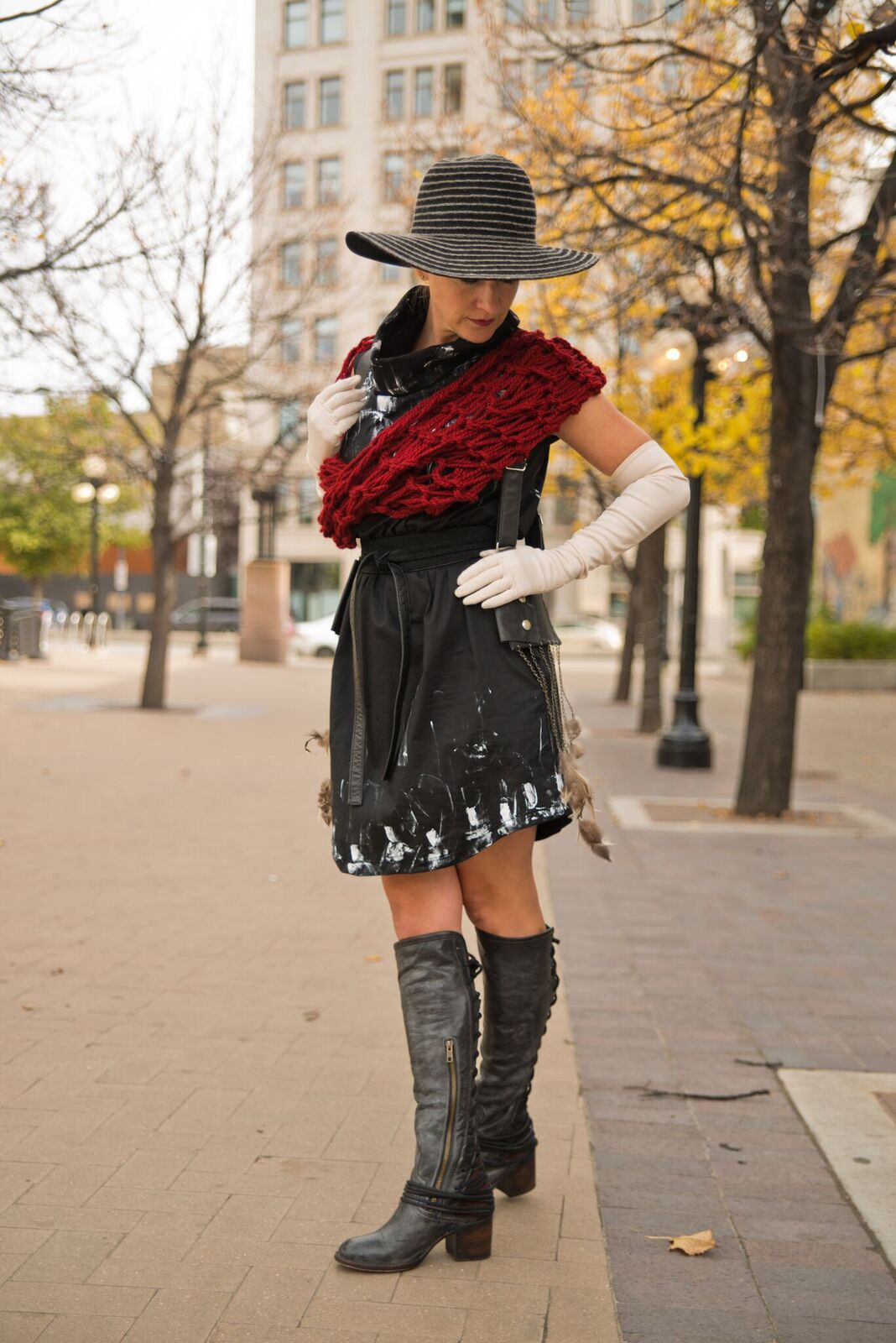 Dress, scarf, and holster by Lennard Taylor. Hat from The Haberdashery. Boots from Rooster shoes.